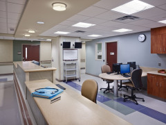 The expanded neuroscience unit at Somerset Medical Center utilizes existing partitions in the new floor layout, reducing costs and saving time in the construction schedule. New lighting fixtures above new multi-height touchdown areas make the nurses' station appear larger and a dedicated computer work station increases efficiency.