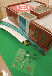 A model of the Akron Children's Hospital's $200-million expansion project was built out of several dozen different types of LEGO bricks. The model required more than 12,000 pieces that took roughly 120 volunteer hours to construct. It stands 13 inches tall and 2 feet, 10 inches across, resting on a 4-foot-square platform. The model may eventually find a home on display in the new building when it's completed in 2015.