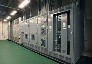 Existing switchgear with upgraded output breakers for CHP interconnection.