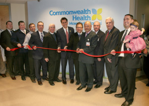 From left, State Rep. Marty Flynn; Lackawanna County Commissioner Patrick O'Malley; Richard Bradshaw, executive director of the Ronald McDonald House of Scranton; Scranton Mayor William Courtright; Reverend Dan Jones, pastoral care coordinator of Moses Taylor Hospital; Cor Catena, CEO, Commonwealth Health; Stanley Blondek, M.D., pediatrician; Mikhail Mirer, M.D., pediatric hospitalist, Penn State Hershey; Ron Ziobro, assistant CEO, Moses Taylor; Doug Allen, chairman, Moses Taylor Board of Trustees and Justin Davis, CEO, holding his daughter Serafina.