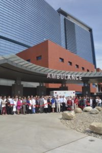 Photo caption: Stamford Health staff and volunteers join President and CEO Brian G. Grissler to cut the ribbon outside of the emergency department and celebrate the official opening of the new Stamford Hospital.